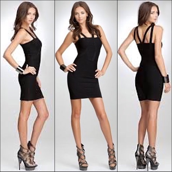 bebe Dresses & Skirts - Bebe sheer lace halter/criss-cross bandage dress 0